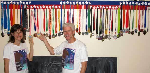 Karen and Carl show off their half-marathon medals from all 50 states.