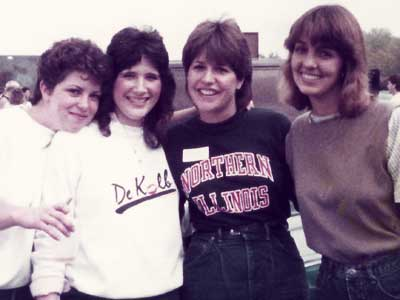 Karen Joens Johnson (second from right) attends an NIU tailgate in October of 1984.
