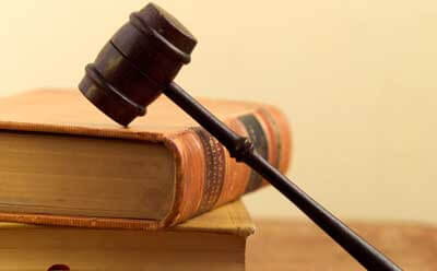 Photo of a gavel resting on law books