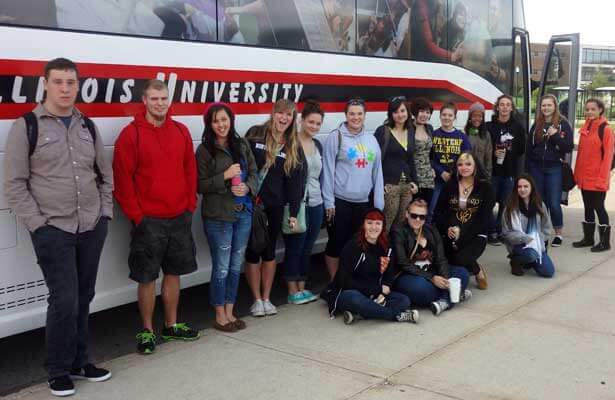 Students in a Fall 2013 TLC prepare to board the bus.