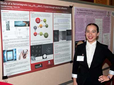 Gabriela Arriaga stands with her poster as the Summer Research Symposium.