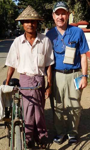 Clymer poses with a pedicab driver in Sittwe during a short trip to Rakhine State in Burma.