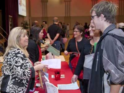 Academic representatives meet with prospective students at NIU Interest Fair.