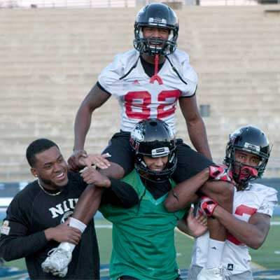 Ware rides the shoulders of his teammates during a Poinsettia Bowl practice.
