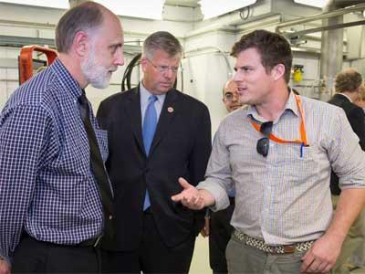 Northern Illinois University student Francois Lemery (right) talks with NIU President Douglas Baker (left) and Congressman Randy Hultgren. Photo: Reidar Hahn