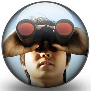 Photo of a man looking through binoculars