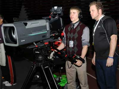 DHS student Owen Smith operates the video camera under the supervision of NIU Media Services student worker Wesley Lynch.