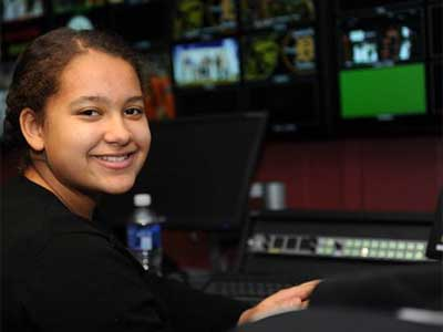 Sycamore High School freshman Emani Brinkman works Feb. 7 in the NIU Convocation Center video production control room.