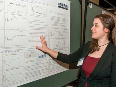 Ellen Raimondi looks over her research poster during the annual meeting of the American Association for the Advancement of Science.