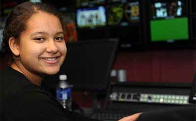 Sycamore High School freshman Emani Brinkman works Feb. 7in the NIU Convocation Center video production control room.