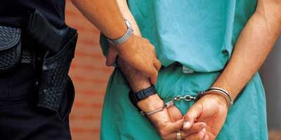 Photo of a prisoner in handcuffs