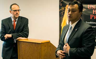 """Bankers Arthur Pesavento (left) and Allan De Guzman told honors students on """"Souper Wednesday"""" to be socially savvy and aware of current events."""