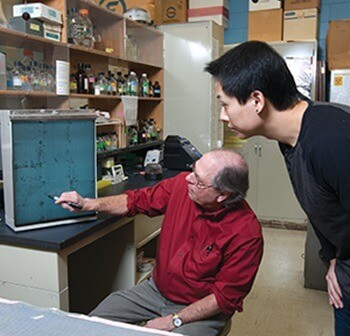 Tom Sims and doctoral student Qinzhou Qi