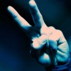 "Photo of a hand with two fingers making the ""peace"" sign"