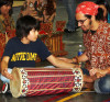 DeKalb middle-schooler Tony Un learns how to play the drum in the Balinese gamelan from NIU Gamelan Ensemble member Manuel Montalvo at Culture Fest 2013.