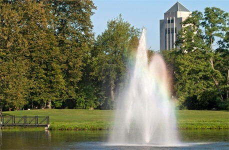 Photo of the East Lagoon fountain with the Holmes Student Center in the background