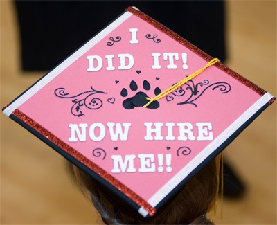 "Photo of an NIU graduation cap: ""I did it! Now hire me!"""