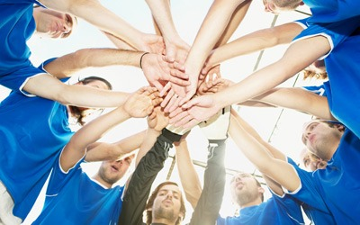 Photo of a sports team huddle
