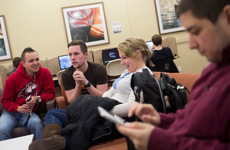 NIU students in a residence hall lobby area
