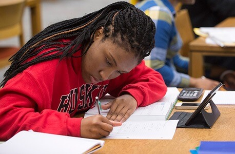 Photo of an NIU student studying in Founders Memorial Library