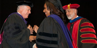 Gov. Pat Quinn and NIU President Doug Baker greet Illinois Sen. Toi W. Hutchinson during the NIU College of Law commencement.
