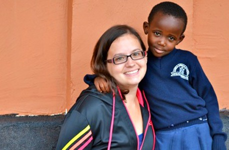 New NIU alumna Lucia Hoffman and Caren, a pre-school student who lives at the Amka Afrika hostel.