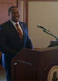 Elliot Echols speaks to the NIU Board of Trustees after being honored in a June 19 meeting.