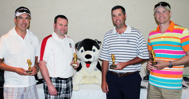 The winning foursome at the 2014 NIU Law Golf Outing included (from left): Jason Hiland, president/CEO of HurricaneGolf.com and Diamond Tour Golf; Alumni Council member Riley Oncken ('04), Riley N. Oncken, P.C.; Grant Goltz, vice president at National Bank and Trust Co.; and Dr. Jason Friedrichs, CGH Medical Center.