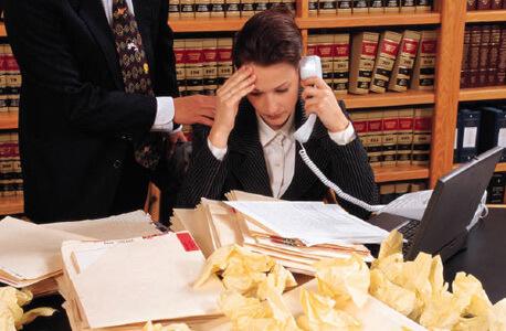 Photo of an employee under stress