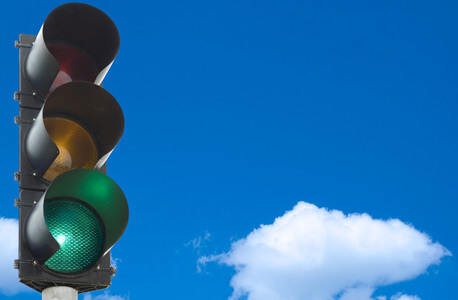 "Photo of a traffic light on ""green"""