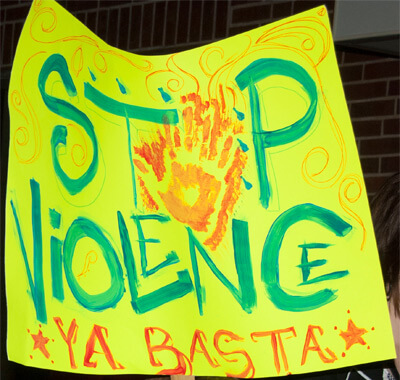 "Photo of a ""Stop Violence"" poster"