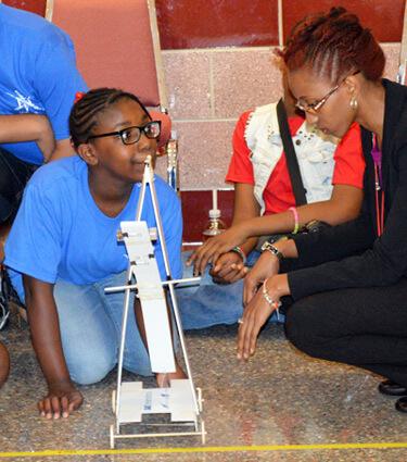NIU student Jessica Puckett mentors a SEEK camper.