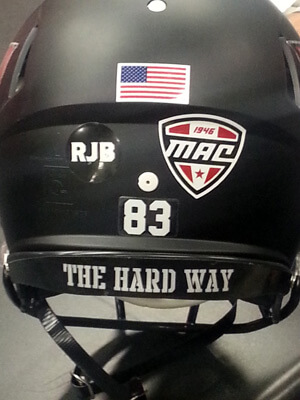 Photo of an NIU football helmet with Bob Brigham's initials