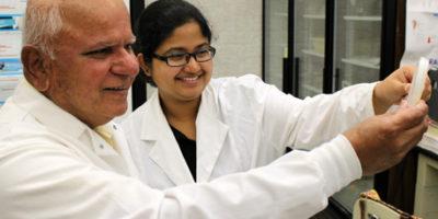 "NIU biologist Rangaswamy ""Nathan"" Meganathan works with Debarati Ghose, a graduate student in biology."