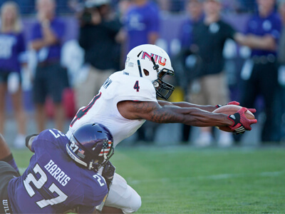 Da'Ron Brown lunges forward for the first of two scores at Northwestern