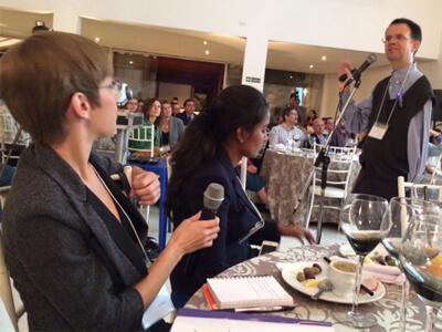 Senior Ashlyn Shellito asks a question following a talk by Professor Cornell