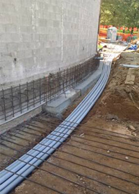 Electrical conduits and rebar along north wall of O'Connell Theatre