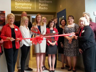 Members of the Rockford Chamber of Commerce join employees of Northern Public Radio and the Rockford Symphony Orchestra to celebrate the opening of their shared space offices at the Riverfront Museum Park in Rockford. (Photo by Sue Stephens)