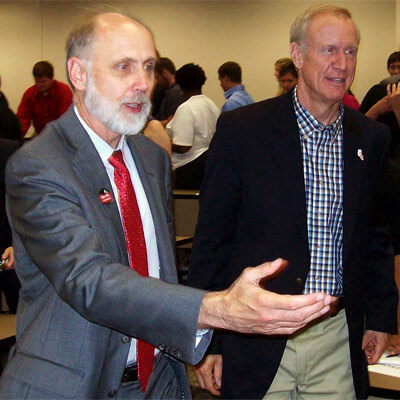 NIU President Doug Baker escorts Illinois gubernatorial candidate Bruce Rauner at the NIU College of Business Wednesday.
