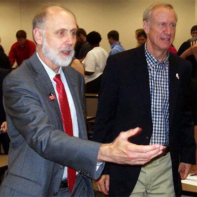 NIU President Doug Baker escorts Illinois gubernatorial candidate Bruce Rauner at the NIU College of Business Wednesday.