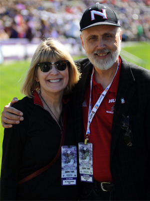 President Doug Baker and Dana Stover attend the NIU football game at Northwestern.