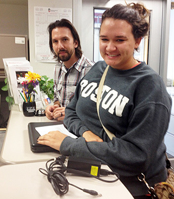 Maddie Gatz, a junior rehabilitation services major, received help at the DoIT Contact Center from Matthew Leman, DoIT computer analyst and technician.