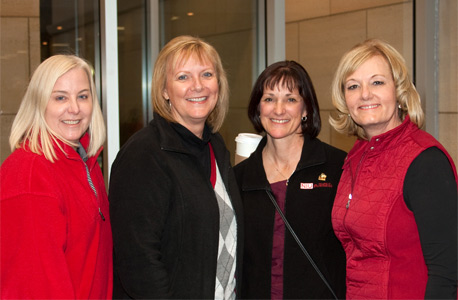 Hopkins (right) joins Lori Marcelllus, Denise Orlando and Barbara Fox at the NIU College of Business 50th Anniversary celebration in 2011.