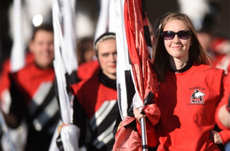 Huskie Marching Band color guard