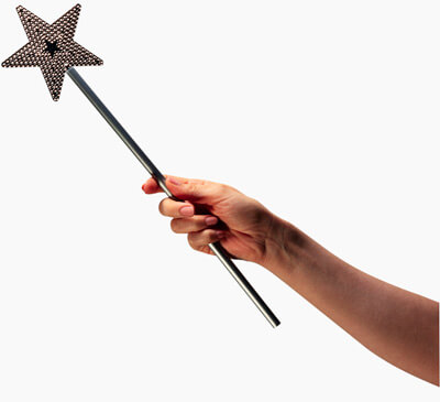 Photo of a hand holding a magic wand