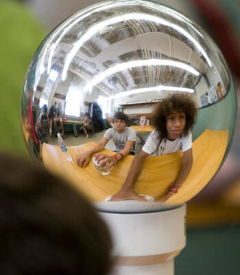 Boys look at their reflections in a crystal ball