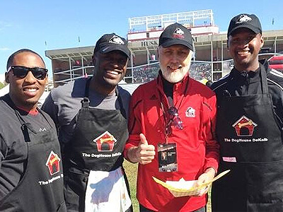 """Elliot Echols, Jordan Delegal and Keith Otis pause for a photo with NIU President Doug Baker in """"The Yard"""""""