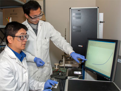 Professor Tao Xu (left) and Ph.D. student Qinglong Jiang