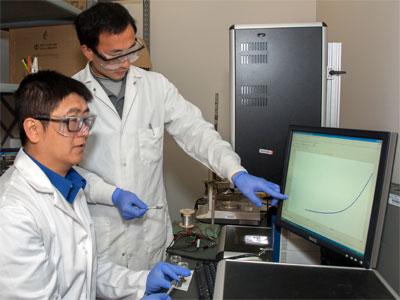 Professor Tao Xu (left) and Ph.D. student Qinglong Jiang