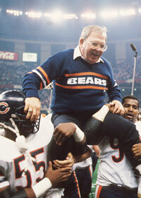 Otis Wilson (L) and Richard Dent carry defensive coordinator Buddy Ryan off the field following the Bears' 46-10 win over the Patriots in Super Bowl XX.